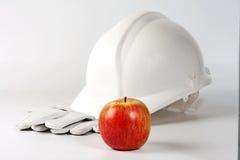 Harter Hut, Handschuhe und Apfel Stockbilder