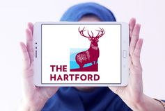 The Hartford insurance company logo. Logo of The Hartford company on samsung tablet holded by arab muslim woman. The Hartford is a United States based investment Royalty Free Stock Images