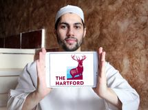 The Hartford insurance company logo. Logo of The Hartford company on samsung tablet holded by arab muslim man. The Hartford is a United States based investment Royalty Free Stock Photo