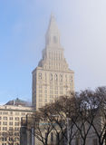Hartford Landmark. Lifting fog reveals the Travelers Tower in downtown Hartford Stock Images