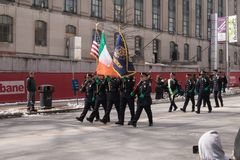 Hartford police department members march in the St. Patrick`s Day parade. Several members of the Hartford, Connecticut police department march in the city`s St Stock Image