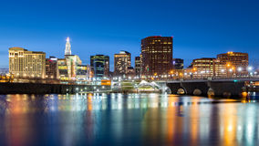 Hartford skyline and Founders Bridge at dusk Royalty Free Stock Image