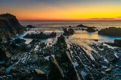 Hartland kaj efter solnedgång arkivfoton