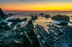 Hartland kaj efter solnedgång fotografering för bildbyråer