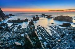 Hartland kaj efter solnedgång arkivbilder