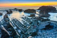 Hartland kaj efter solnedgång arkivbild