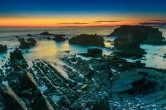 Hartland kaj efter solnedgång arkivfoto