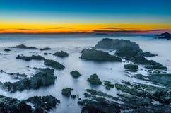 Hartland kaj efter solnedgång royaltyfri fotografi