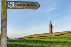 Hartshead Pike Tameside Pennine England. Arrow showing the direction of Hartshead Pike which is a hill in Tameside in Greater Manchester, England, and its name Stock Images