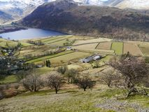 Hartsop hamlet with fields and Brothers Water Royalty Free Stock Photo