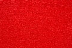 Hartstochtelijke rode kunstleerachtergrond Exclusief rood leer royalty-vrije stock foto's