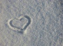 Hartsymbool op de sneeuw stock fotografie