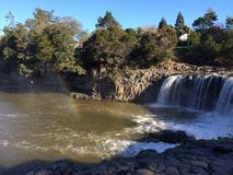 Haruru falls with a rainbow. Haruru Falls creates a rainbow. Haruru falls is located near Paihia, the main tourist town in the Bay of Islands, North Island, New stock photos