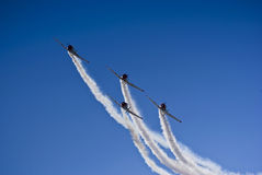 Harvard Aerobatic Team, Incoming. Harvard aerobatic team, in a display of four up formation flying, with smoke trails Royalty Free Stock Image