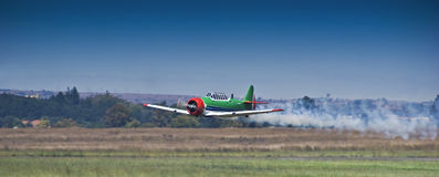 Harvard Aerobatic Team, Smoke On, Flyby. Harvard aerobatic team treating spectators to a marvelous display of a low altitude flyby, with smoke on Stock Photography