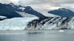 Harvard Glacier College Fjord Alaska Harvard Arm with Snow Covered Mountain Peaks and calm Pacific Ocean with Icebergs from a dist stock photos