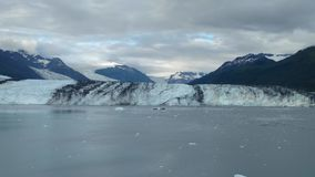 Harvard Glacier College Fjord Alaska Harvard Arm with Snow Covered Mountain Peaks and calm Pacific Ocean with Icebergs from a dist royalty free stock photo