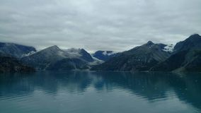 Harvard Glacier College Fjord Alaska. Large Glacier sliding into the Pacific Ocean in Alaska stock photos