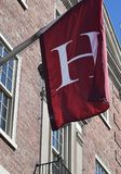 Harvard `H` Flag Harvard Square, MA royalty free stock image