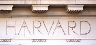 Harvard Letters on a University Building. The Word Harvard chiseled into the limestone of a university building in Cambridge, MA (taken on August 5, 2011 Royalty Free Stock Photo