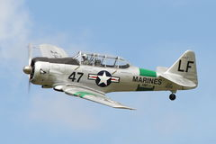 Harvard Warbird Aircraft Slow Pass. This aircraft was built for the US Navy in 1943, and post-service was a Reno Racer, one of the fastest in the world. Flown by Royalty Free Stock Image