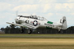 Harvard Warbird Aircraft Take-Off. This aircraft was built for the US Navy in 1943, and post-service was a Reno Racer, one of the fastest in the world. Flown by Royalty Free Stock Images