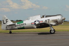 Harvard Warbird Aircraft Taxis. This aircraft was built for the US Navy in 1943, and post-service was a Reno Racer, one of the fastest in the world. Flown by Royalty Free Stock Photo