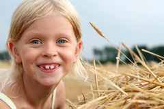 After harvest. Little girl on the stubble Stock Images