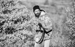 Harvest animals typically restricted. Guy hunting nature environment. Bearded hunter rifle nature background. Hunting. Hobby concept. Hunting season. Experience stock photo