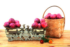The harvest of autumn apples. Autumn apples in the basket and on the old mechanical scales Royalty Free Stock Images