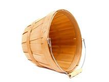 Harvest basket. Empty wooden harvest basket on a white background Stock Images