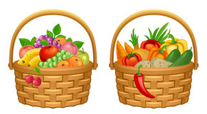Harvest basket. Vegetables and fruits on a white background Stock Photos