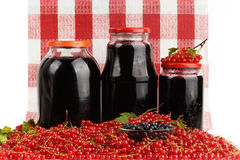 Harvest of berries and home preserves. Royalty Free Stock Photos