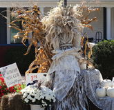 Harvest Bride Scarecrow. Halloween Scarecrow Bride with pumpkins and chrysanthemums Stock Photography