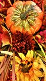 Harvest Centerpiece display with pumpkin and sunflower. Harvest, Thanksgiving centerpiece display from aerial perspective, with pumpkin, sunflower and mums in Stock Photos
