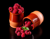 Harvest delicious raspberries. In a ceramic pot Stock Images