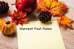 Harvest Fest concept. Harvest Fest list concept on notebook and wooden board Royalty Free Stock Images