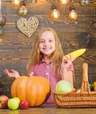 Harvest festival concept. Child little girl enjoy farm life. Organic gardening. Grow your own organic food. Girl kid at royalty free stock images