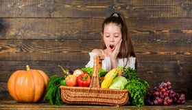 Harvest festival concept. Girl kid rustic style farmers market with fall harvest. Child cheerful celebrate harvest stock images