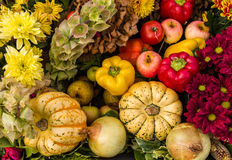 Autumn  Fruit Flowers and Vegetables. Colourful autumn harvest festival display of a variety of fruit, vegetables and flowers Royalty Free Stock Photos