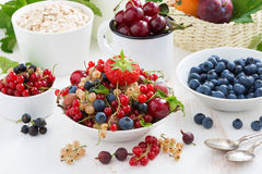 Harvest of fresh berries and fruits on white wooden table Royalty Free Stock Photos