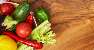 Harvest of fresh vegetables and greens on the boards, top view Royalty Free Stock Images