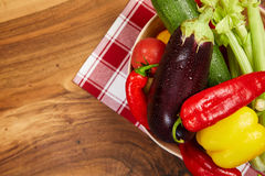 Harvest of fresh vegetables and greens on the boards, top view Royalty Free Stock Photo