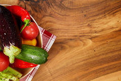 Harvest of fresh vegetables and greens on the boards, top view Royalty Free Stock Image