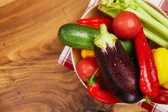 Harvest of fresh vegetables and greens on the boards, top view Stock Photography