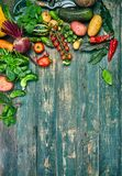 Harvest fresh vegetables on old wooden board top view rustic style autumn still life gardening copyspace. Stock Photography
