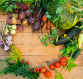 Harvest of fresh vegetables on wooden background. Top view. Potatoes, carrot, squash, peas, tomatoes Stock Photography