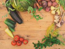 Harvest of fresh vegetables on wooden background. Top view. Potatoes, carrot, squash, peas, tomatoes Royalty Free Stock Photos