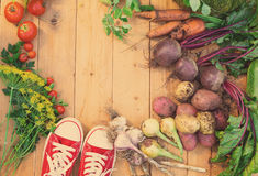 Harvest of fresh vegetables on wooden background. Top view. Potatoes, carrot, squash, peas, tomatoes Royalty Free Stock Image