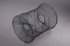 Harvest gear of Eel cylindrical cage. On grey background Stock Photo